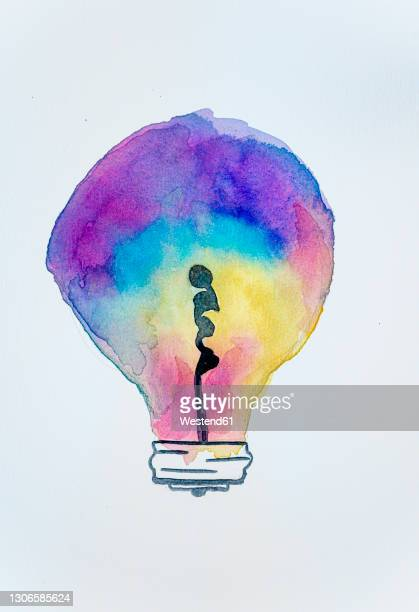illustration of multi colored light bulb painting on white background - colour gradient stock illustrations