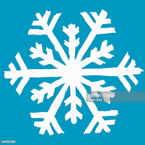 Illustration of snow flake against blue background