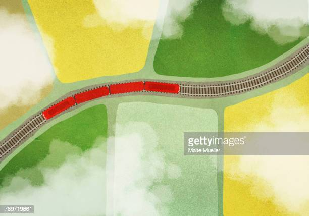 Illustration of train on tracks amidst field