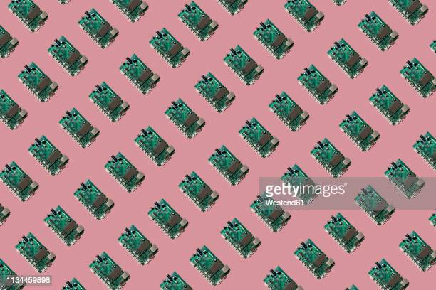 3d illustration, row of motherboards, pink background - technology stock illustrations