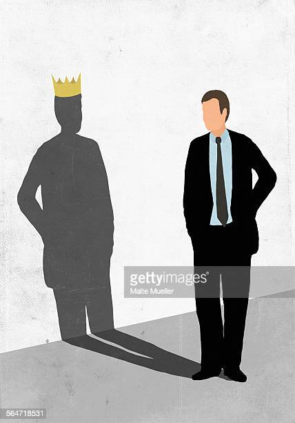 illustrative image of businessman looking at his shadow wearing crown on white wall representing asp - ruler stock illustrations