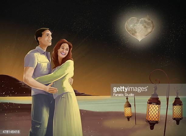 ilustrações de stock, clip art, desenhos animados e ícones de illustrative image of couple embracing on beach at night with heart shape moon - homens jovens