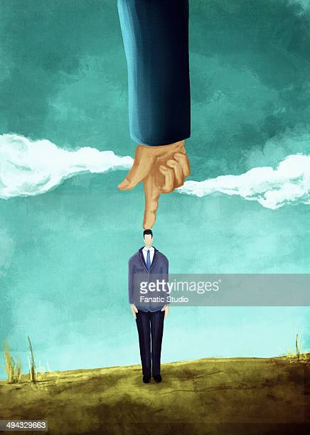 illustrative image of hand pointing on businessman's head representing domination - office politics stock illustrations, clip art, cartoons, & icons