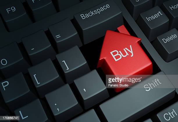 illustrative image of keyboard with house button representing online property deal - online advertising stock illustrations, clip art, cartoons, & icons