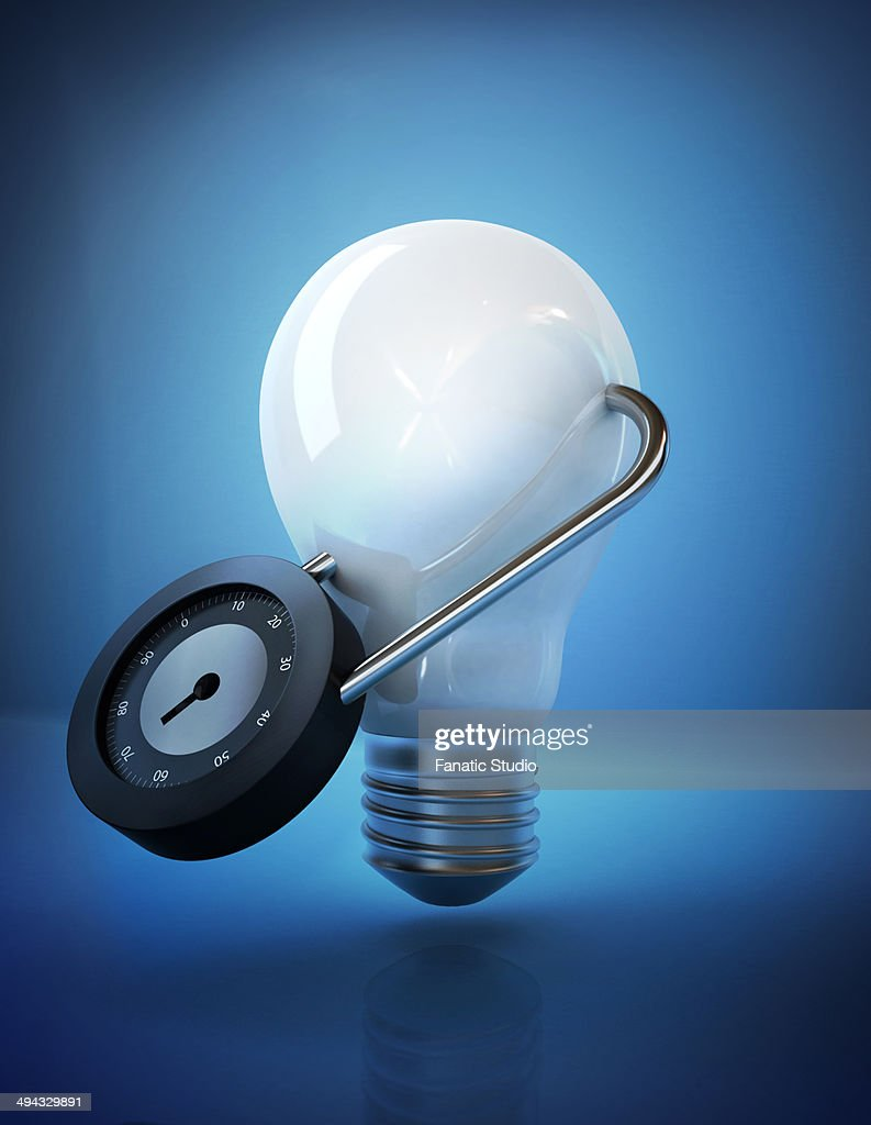 Illustrative image of light bulb locked with padlock representing security of ideas : stock illustration