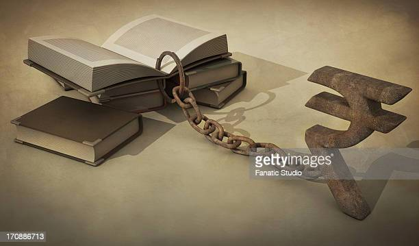 Illustrative image of metal chain attached to book and rupee sign representing education cost