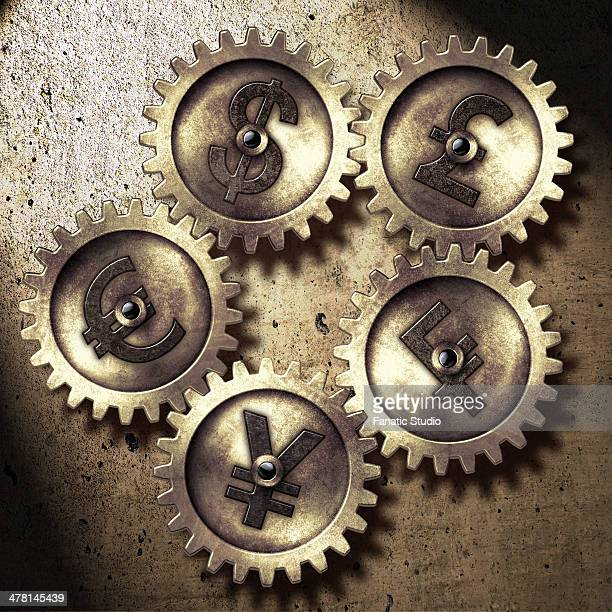 illustrative image of various currency signs on gears representing currency exchange - franc sign stock illustrations, clip art, cartoons, & icons