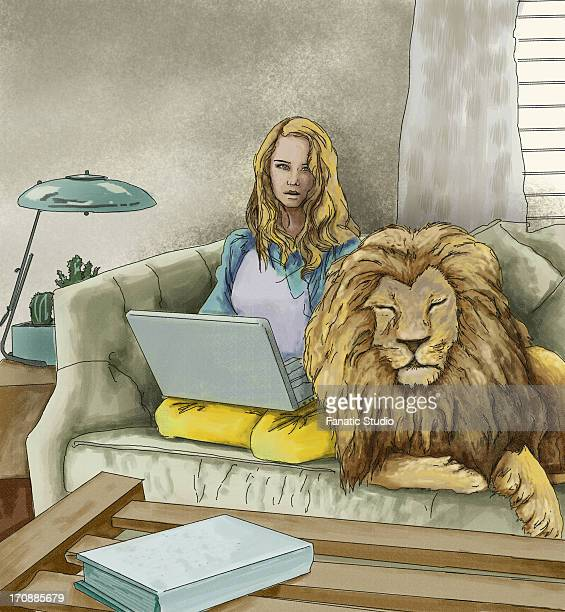 Illustrative image of woman with laptop sitting beside lion on sofa