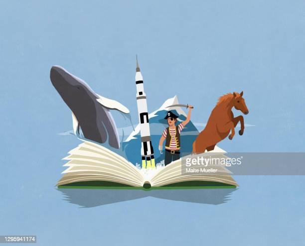 imaginative boy pirate reading adventure travel book - opportunity stock illustrations