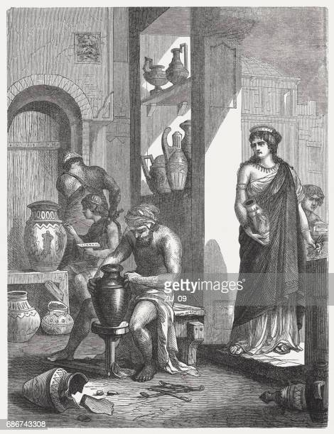 in an etruscan pottery, wood engraving, published in 1880 - etruscan stock illustrations