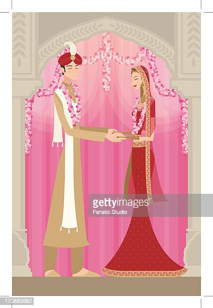 Indian bride and groom in traditional dress at wedding ceremony