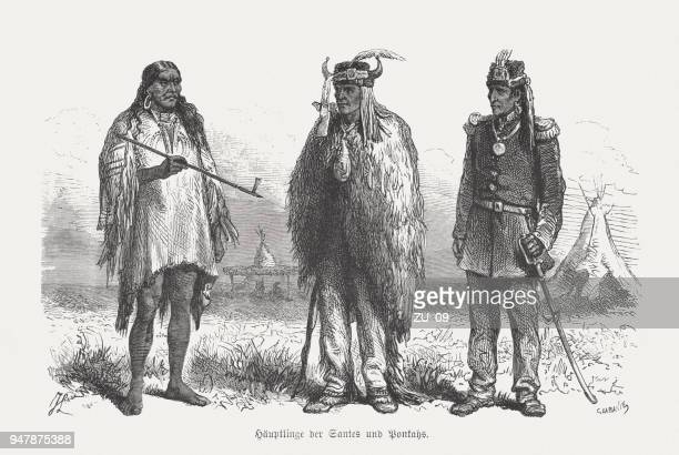 indian chiefs of santee and ponca (sioux), woodcut, published 1868 - indigenous north american culture stock illustrations, clip art, cartoons, & icons