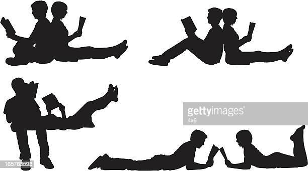 intellectual couple reading together - back to back stock illustrations, clip art, cartoons, & icons
