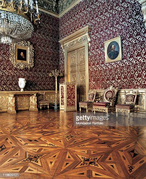 Italy; Piemonte; Turin; Royal Palace; secondo piano. View interior Royal Palace Turin Audience Chamber parquet floor armchair gold red pictures door