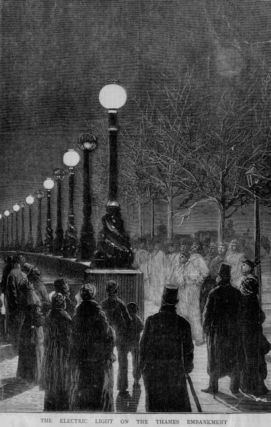 A group of people viewing some electric street lights...