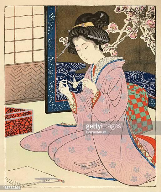 japanese woodblock of a female making origami - geisha stock illustrations, clip art, cartoons, & icons