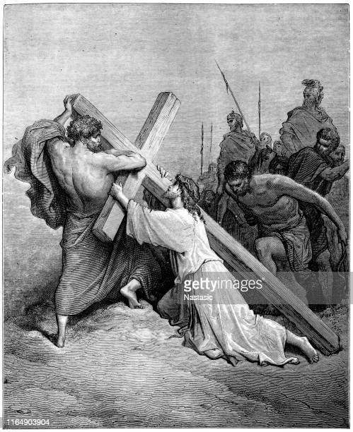 jesus falling beneath the cross - biblical event stock illustrations