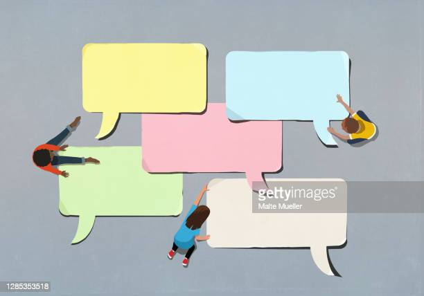 kids arranging blank multicolor speech bubbles - technology stock illustrations