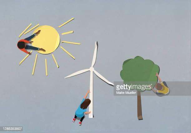 kids arranging environment and wind turbine paper symbols - order stock illustrations