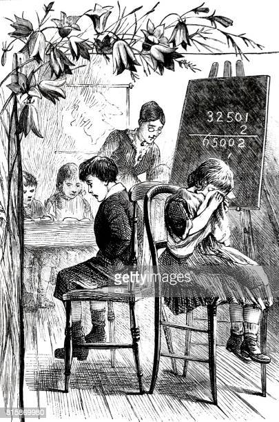 Kids in classroom sitting on chairs in front of blackboard being sad doing maths