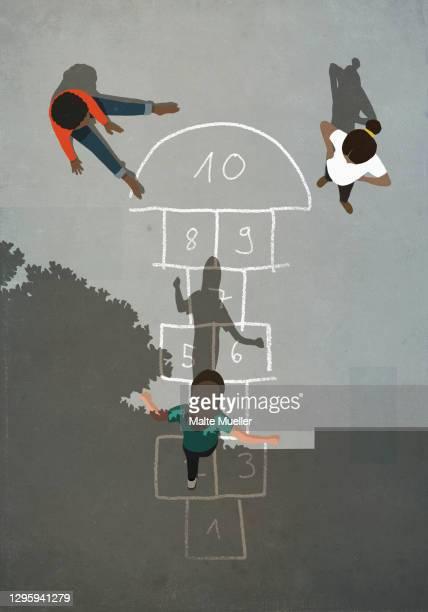 kids playing hopscotch on sunny pavement - full length stock illustrations