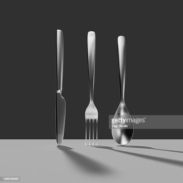 knife and fork and spoon - in a row stock illustrations