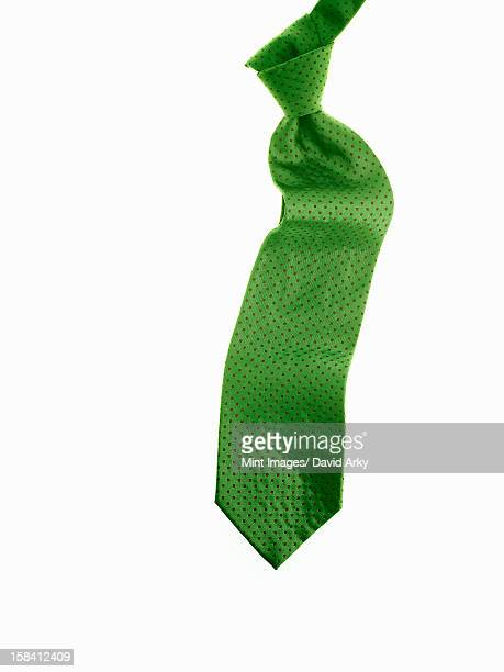 A knotted green fabric tie, or necktie.