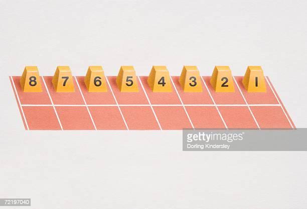 Lane number blocks arranged for 'straight start' on racing track.