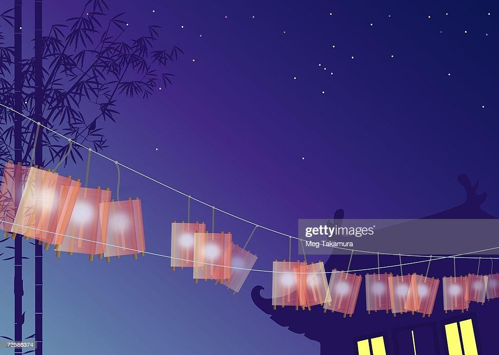 Lanterns hanging on a rope : Stock Illustration