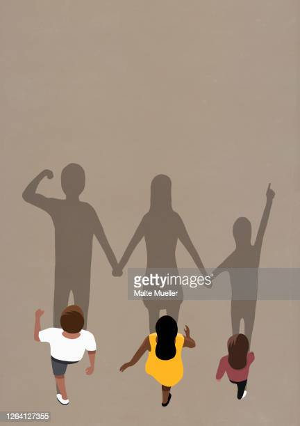 large shadows of family walking - family stock illustrations