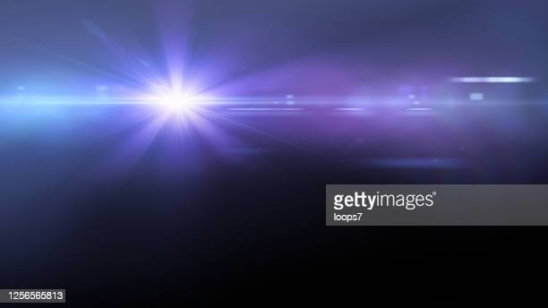 lens flare auf dark - blendenfleck stock-grafiken, -clipart, -cartoons und -symbole