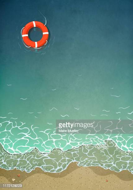 life ring floating in ocean water - head above water stock illustrations