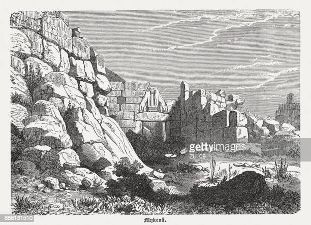 lion gate of mycenae, greece, wood engraving, published in 1880 - mycenae stock illustrations