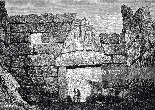 lion gate of mycenae - mycenae stock illustrations