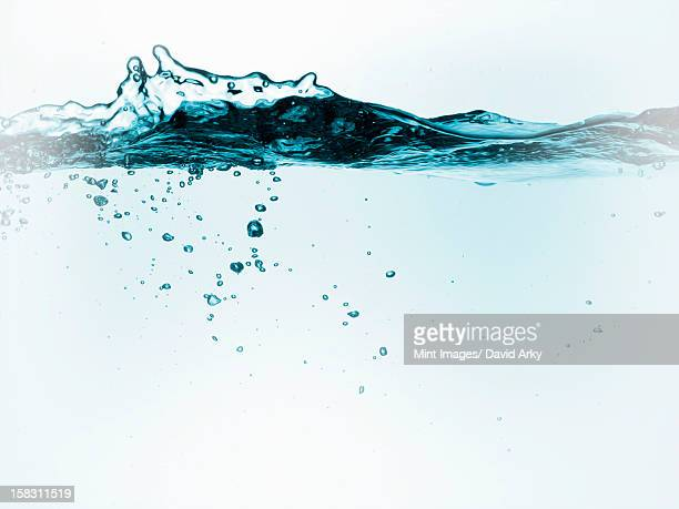 liquid in a container, with moving water and air bubbles. - cross section stock illustrations