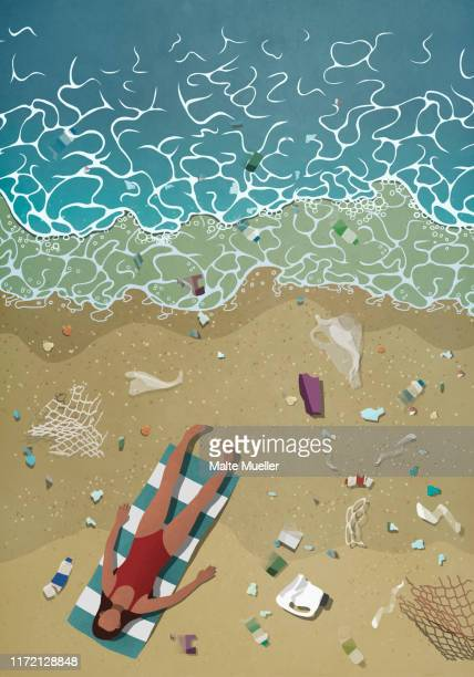 litter surrounding woman sunbathing on ocean beach - water pollution stock illustrations