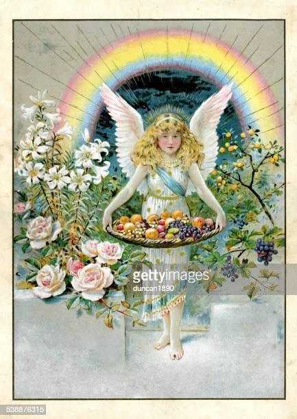 Little angel holding a basket of fresh fruit