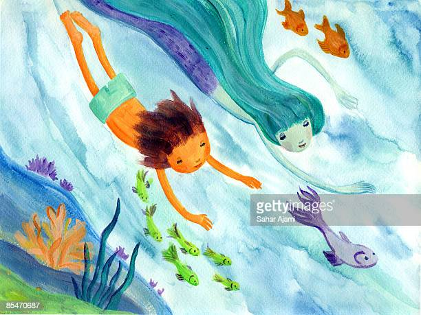 A little boy swimming with a mermaid