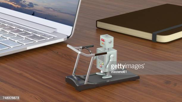 Little robot exercising on treadmill, standing on a desk with laptop and notebook