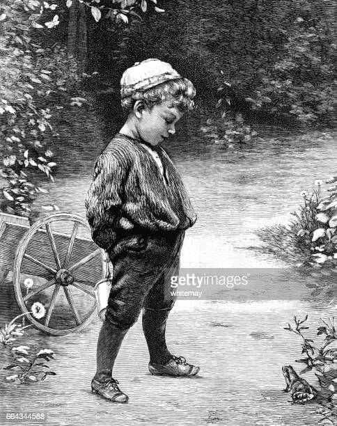 Little Victorian boy looking at a frog