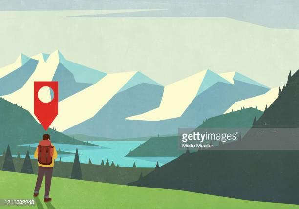 location pin above male backpacker enjoying scenic mountain view - gps stock-grafiken, -clipart, -cartoons und -symbole