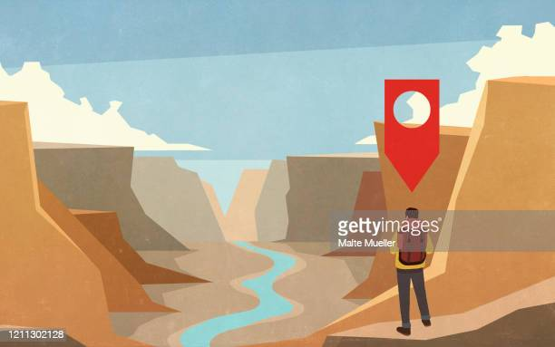 location pin above male hiker in scenic canyon - rear view stock illustrations