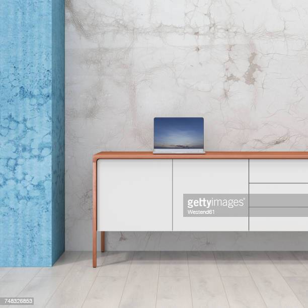 Loft with laptop on retro style sideboard