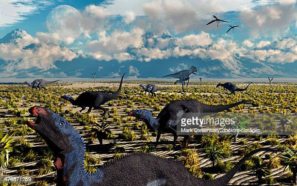 A lone Allosaurus attacking a herd of herbivorous Camptosaurus dinosaurs.
