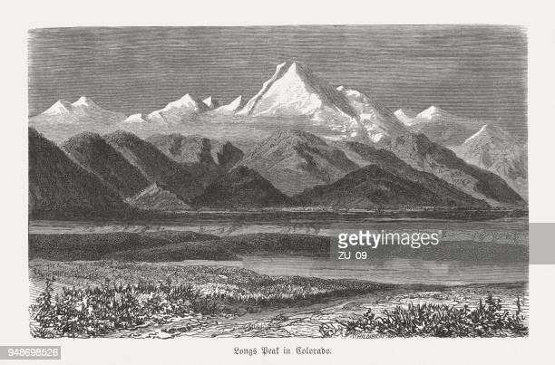 longs peak in colorado, usa, wood engraving, published in 1868 - front range mountain range stock illustrations