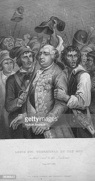 Louis XVI, , King of France from 1774, is threatened by the mob in the Tuileries, Paris.