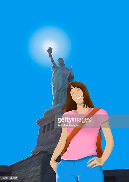 low angle view of a woman smiling and standing in front of a monument - liberty island stock illustrations, clip art, cartoons, & icons