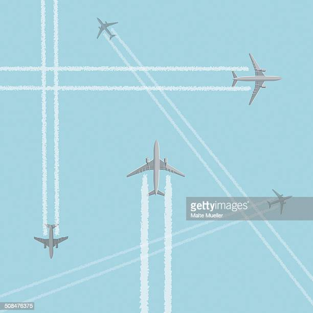 low angle view of airplanes with crisscross vapor trails against clear sky - journey stock illustrations
