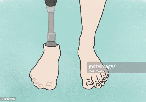 Low section of man with artificial limb over blue background