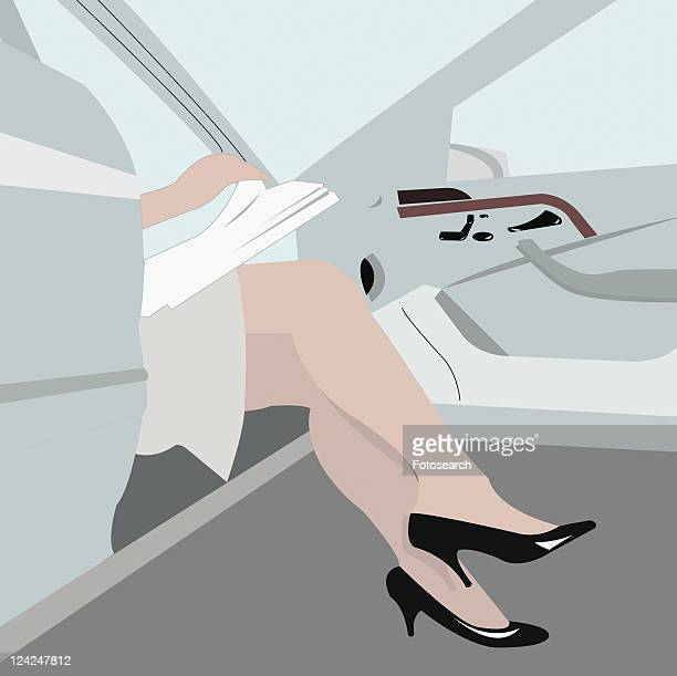 Low section view of a woman exiting from a car